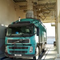 Bulk solids loading to open bulk trucks by loading bellows