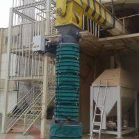 Bulk material loading spout for trucks